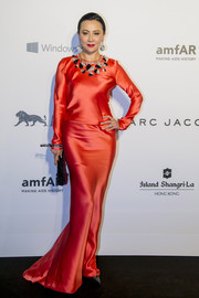Carina Lau looked radiant in a deep-coral Schiaparelli Couture gown with a bejeweled neckline at the amfAR Hong Kong Gala.