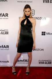 Andreja Pejic vamped it up in a tight black cutout dress by Gucci at the amfAR Inspiration Gala.