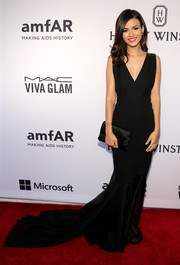 Victoria Justice went for classic glamour in a plunging black mermaid gown by Donna Karan during the amfAR Inspiration Gala.