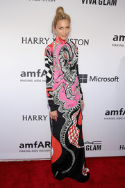 For her amfAR Inspiration Gala look, Anja Rubik chose an Emilio Pucci gown that was conservative in cut yet bold in print.