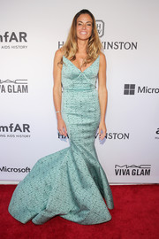 Kelly Bensimon cut an ultra-feminine silhouette in a turquoise mermaid gown during the amfAR Inspiration Gala.