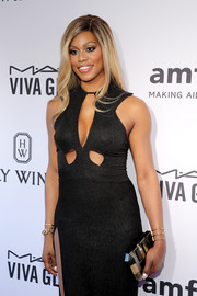 Laverne Cox paired a metal-accented Emm Kuo clutch with a sexy cutout dress for the amfAR Inspiration Gala.