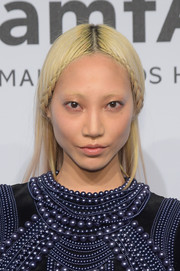 Soo Joo Park caught eyes at the amfAR New York Gala with her severe platinum-blonde locks parted down the center with braids on both sides.