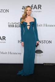 Heather Marks was a head turner in a slinky teal Cushnie et Ochs cutout gown during the amfAR New York Gala.