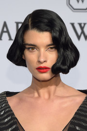 Crystal Renn added a bright spot with a swipe of red lipstick.