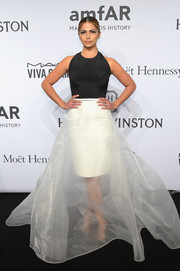 Camila Alves chose a Romona Keveza gown, featuring a voluminous swath of white tulle with a pencil skirt underlay, for the amfAR New York Gala.
