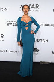 Lais Ribeiro sheathed her gorgeous figure in a sexy teal cutout gown by Cushnie et Ochs for the amfAR New York Gala.