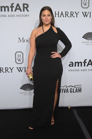 Ashley Graham sheathed her curves in a tight black one-sleeve gown with a shoulder cutout and a thigh-high slit for the amfAR New York Gala.
