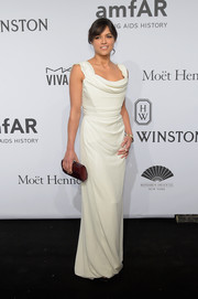Michelle Rodriguez paired her gorgeous dress with a brown hard-case clutch by Kara Ross.