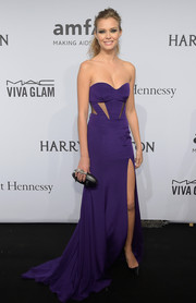 Josephine Skriver was punk-glam at the amfAR New York Gala in a purple Gabriela Cadena strapless gown with multiple cutouts on the bodice.