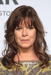 Marcia Gay Harden sported pretty waves and wispy bangs at the amfAR New York Gala.
