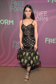 Emeraude Toubia attended the ABC Freeform Upfront looking sultry in a floral corset dress with a mermaid hem.