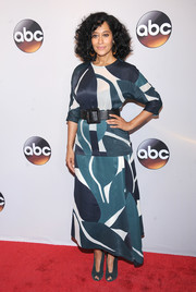 Tracee Ellis Ross pulled her outfit together with teal suede peep-toes by Gianvito Rossi.