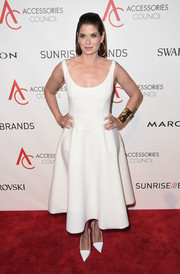Debra Messing matched her frock with pointy white pumps.