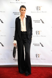 Bridget Moynahan paired a loose black Maiyet pantsuit with a ruffled shirt for the American Ballet Theatre Spring Gala.