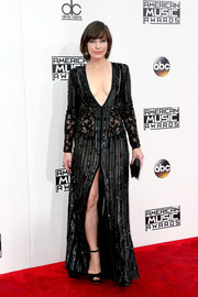 Milla Jovovich complemented her dress with a pair of black ankle-strap peep-toes.