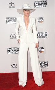 Lady Gaga hit the AMA red carpet in a white Brandon Maxwell suit, which she wore sans shirt for a hint of sexiness.