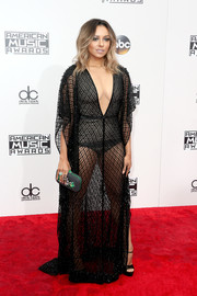 Kat Graham teamed her vampy dress with a beaded clutch by Loriblu.