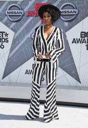 Janelle Monae completed her well-coordinated attire with a black-and-white box clutch.