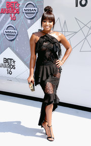 Naturi Naughton donned a frothy lace-panel halter dress by Nina Ricci for the 2016 BET Awards.