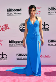 Priyanka Chopra made an appearance at the Billboard Music Awards wearing a sexy blue halter gown by Versace.