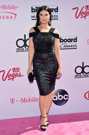 Idina Menzel channeled her inner dominatrix in a fitted black Michael Costello dress with sequined panels and a strappy bodice for the Billboard Music Awards.