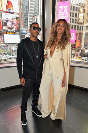 Ciara layered a floor-length silk coat over her jumpsuit for extra oomph.