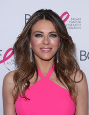 Elizabeth Hurley framed her gorgeous face with this feathered flip for the Hot Pink Party.