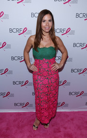 Monique Lhuillier looked Christmassy in a color-block lace strapless dress from her own label during the Hot Pink Party.