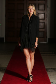 Maria Sharapova teamed a sleek black blazer with a mini dress for the Brisbane International player party.
