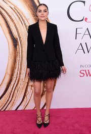 Olivia Culpo dolled up her menswear-inspired top with a feathered mini skirt, also by Kate Spade.