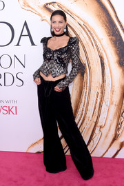 Adriana Lima completed her funky outfit with black bell-bottoms, also by Marc Jacobs.