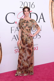 Hilary Rhoda dared to bare in this sheer floral gown by Monique Lhuillier at the 2016 CFDA Fashion Awards.