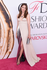 Michelle Monaghan donned a strapless two-tone gown by Off-White, featuring molded cups and a high front slit, for the 2016 CFDA Fashion Awards.