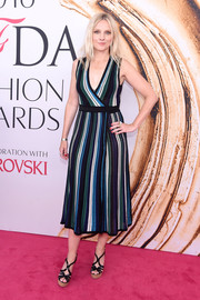 Laura Brown teamed her cute dress with strappy black platform sandals.