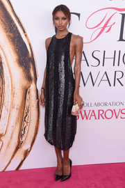 Jasmine Tookes styled her LBD with a faceted gold clutch by Atelier Swarovski.