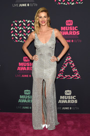 Erin Andrews was a sparkling beauty in a low-cut, high-slit silver gown by Maria Lucia Hohan during the 2016 CMT Music Awards.