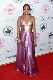 Regina King stunned in an iridescent gown with a cleavage-baring neckline at the 2016 Carousel of Hope Ball.