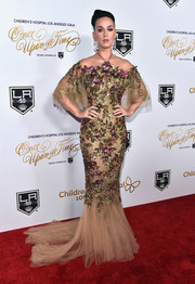 Katy Perry looked breathtaking in a floral-sequined cold-shoulder mermaid gown by Marchesa at the Once Upon a Time Gala.