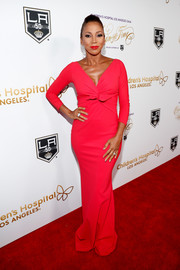 Holly Robinson Peete put her svelte figure on display in a form-fitting red gown at the Once Upon a Time Gala.