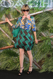 Parker Posey pulled her look together with a pair of cross-strap platform sandals.