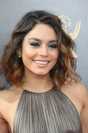 Vanessa Hudgens matched her dress with a metallic smoky eye.