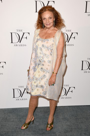 Diane von Furstenberg chose a lovely butterfly-print dress with a matching wrap (from her own line, of course) for her DVF Awards look.