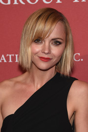 Christina Ricci's red lipstick looked striking against her black outfit!
