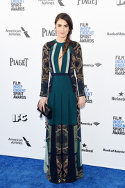 Nikki Reed chose an Etro maxi dress with a keyhole cutout, printed panels, and a pleated skirt for her Film Independent Spirit Awards look.