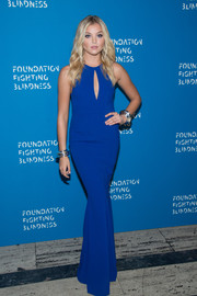 Rachel Hilbert flaunted her incredibly slim physique in a royal-blue keyhole-detail gown by Zac Posen at the Foundation Fighting Blindness World Gala.