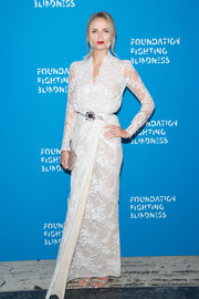 Natasha Poly looked stunning in a long-sleeve white lace gown by Alexander McQueen at the Foundation Fighting Blindness World Gala.
