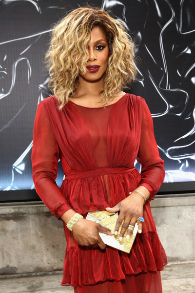 Laverne Cox's gold Emm Kuo box clutch and red gown at the 2016 Fragrance Foundation Awards were a beautiful pairing.