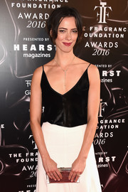 Rebecca Hall arrived for the 2016 Fragrance Foundation Awards sporting a metallic silver clutch and monochrome dress combo.