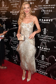 Petra Nemcova kept the shine going with an industrial-chic box clutch by Paula Cademartori.